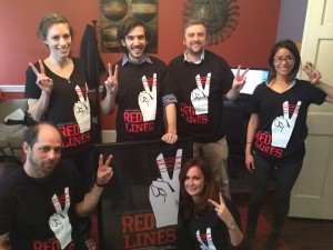 The Spark Media team modeling the Red Lines shirts!