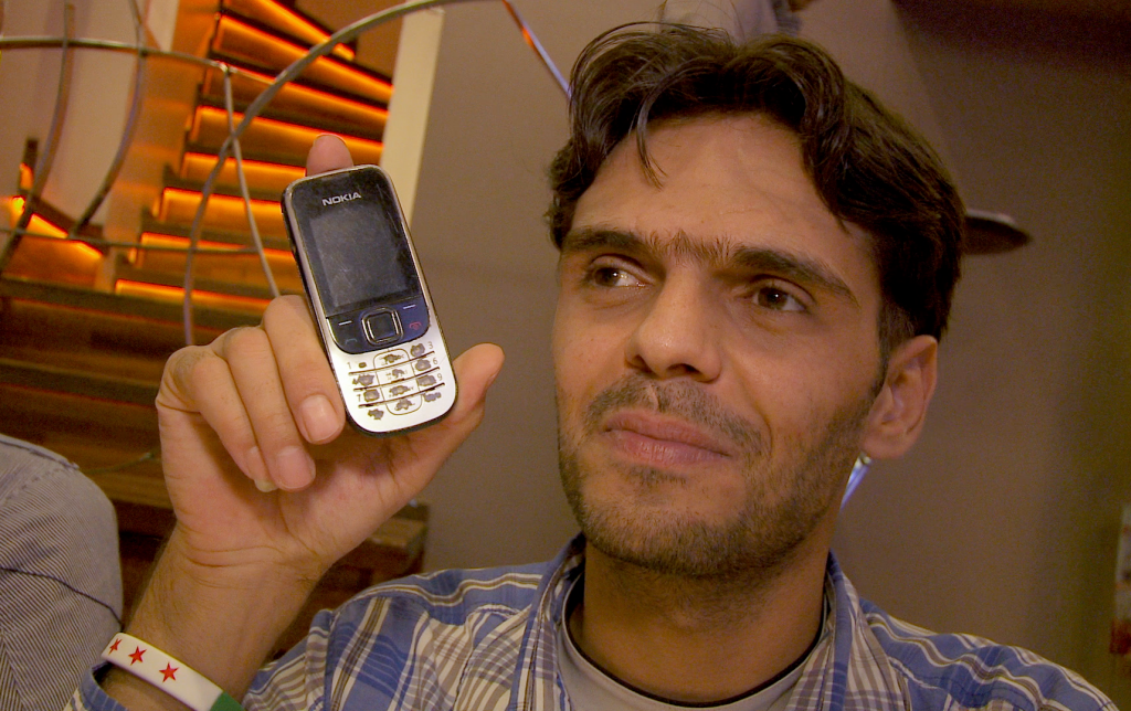 Media Activist Abu Jaffar (pseudonym) shows the first phone he used to record reports from inside Syria.